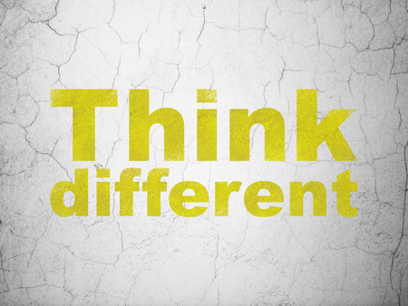 different courses: Studying concept: Yellow Think Different on textured concrete wall background