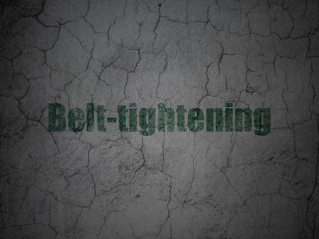 tightening: Finance concept: Green Belt-tightening on grunge textured concrete wall background