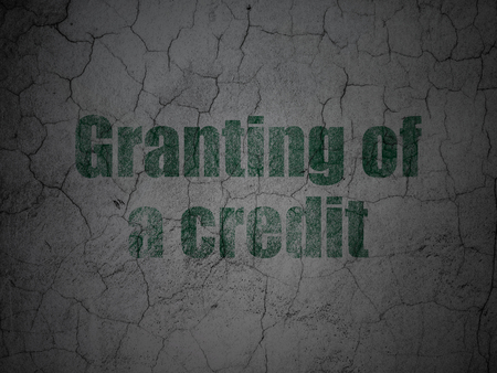granting: Banking concept: Green Granting of A credit on grunge textured concrete wall background