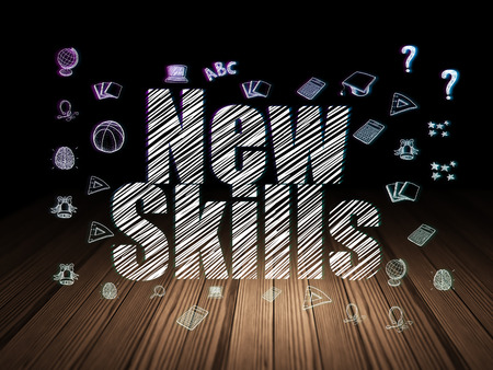 learning new skills: Learning concept: Glowing text New Skills,  Hand Drawn Education Icons in grunge dark room with Wooden Floor, black background