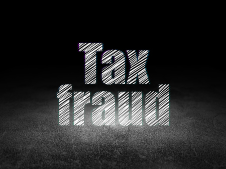Law concept: Glowing text Tax Fraud in grunge dark room with Dirty Floor, black background Stock Photo