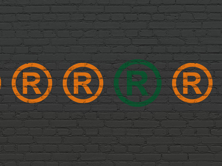 r regulation: Law concept: row of Painted orange registered icons around green registered icon on Black Brick wall background