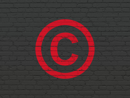 Law concept: Painted red Copyright icon on Black Brick wall background