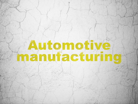 textured wall: Manufacuring concept: Yellow Automotive Manufacturing on textured concrete wall background