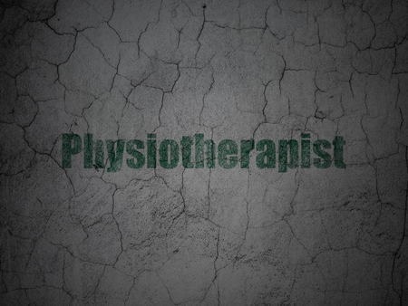 physiotherapist: Healthcare concept: Green Physiotherapist on grunge textured concrete wall background