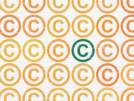 Law concept: rows of Painted orange copyright icons around green copyright icon on White Brick wall background