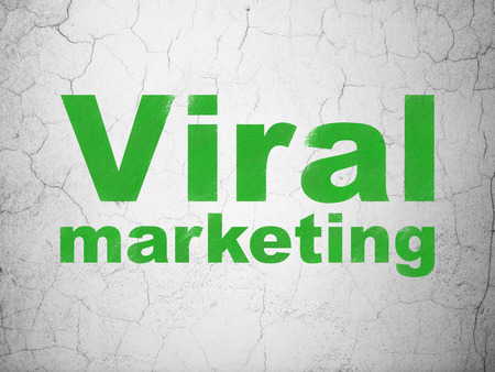textured wall: Advertising concept: Green Viral Marketing on textured concrete wall background