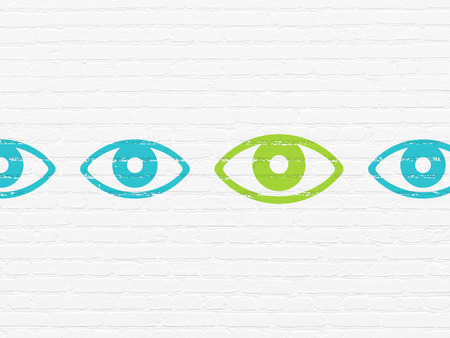 Protection concept: row of Painted blue eye icons around green eye icon on White Brick wall background