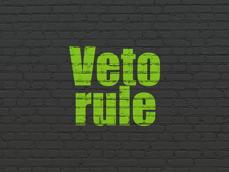 veto: Political concept: Painted green text Veto Rule on Black Brick wall background