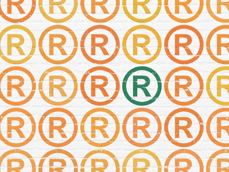 r regulation: Law concept: rows of Painted orange registered icons around green registered icon on White Brick wall background