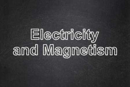 magnetismo: Science concept: text Electricity And Magnetism on Black chalkboard background Archivio Fotografico