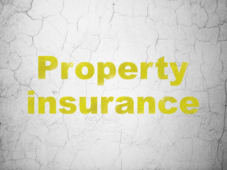textured wall: Insurance concept: Yellow Property Insurance on textured concrete wall background