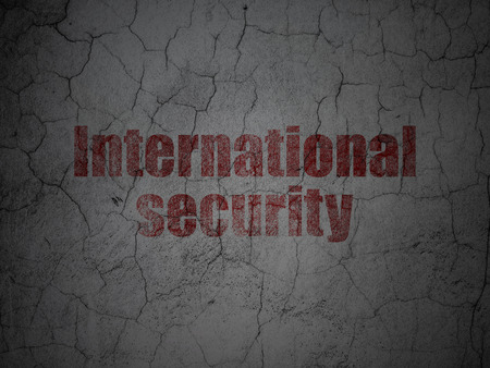 international security: Protection concept: Red International Security on grunge textured concrete wall background