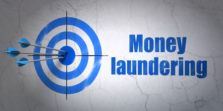 Success money concept: arrows hitting the center of target, Blue Money Laundering on wall background, 3D rendering Stock Photo