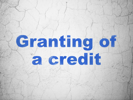 granting: Currency concept: Blue Granting of A credit on textured concrete wall background Stock Photo