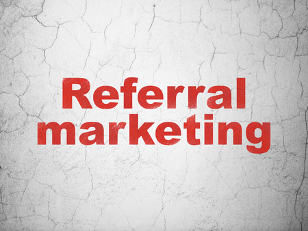 Advertising concept: Red Referral Marketing on textured concrete wall background