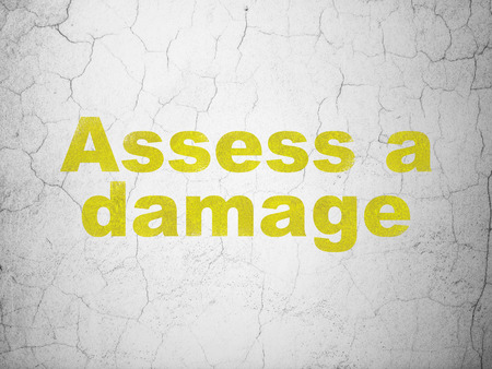 assess: Insurance concept: Yellow Assess A Damage on textured concrete wall background