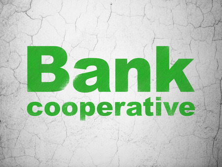 cooperativismo: Currency concept: Green Bank Cooperative on textured concrete wall background Foto de archivo