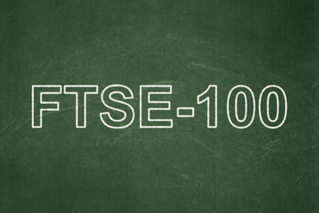 britannia: Stock market indexes concept: text FTSE-100 on Green chalkboard background Stock Photo