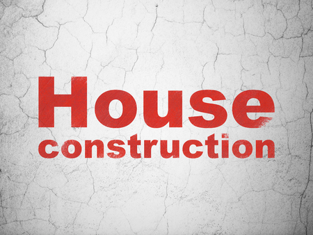 building site: Building construction concept: Red House Construction on textured concrete wall background