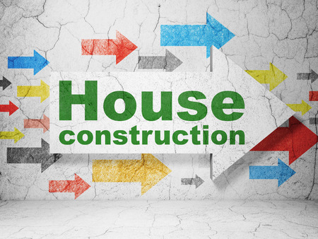 building site: Constructing concept:  arrow with House Construction on grunge textured concrete wall background, 3D rendering Stock Photo