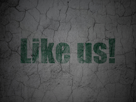 Social media concept: Green Like us! on grunge textured concrete wall background Stock Photo
