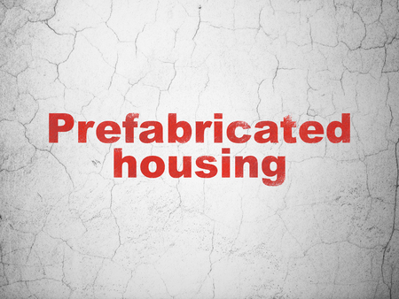 prefabricated: Building construction concept: Red Prefabricated Housing on textured concrete wall background Stock Photo
