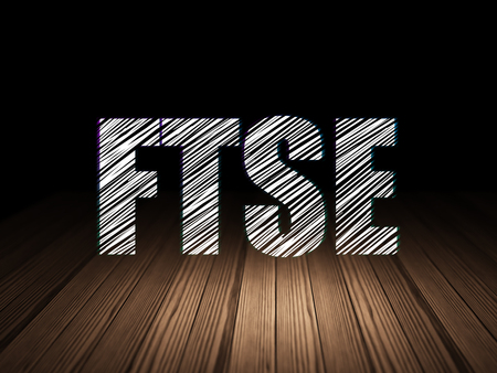 Stock market indexes concept: Glowing text FTSE in grunge dark room with Wooden Floor, black background