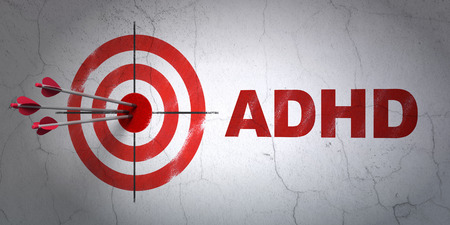 Success Medicine concept: arrows hitting the center of target, Red ADHD on wall background, 3D rendering