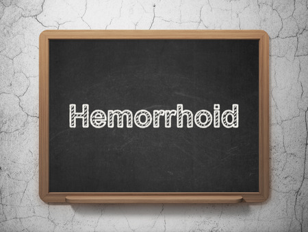 hemorrhoid: Medicine concept: text Hemorrhoid on Black chalkboard on grunge wall background, 3D rendering Stock Photo