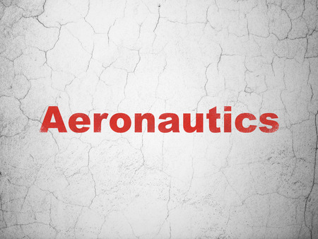 Science concept: Red Aeronautics on textured concrete wall background Stock Photo