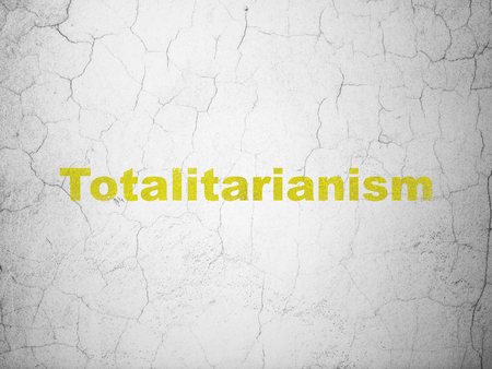 Politics concept: Yellow Totalitarianism on textured concrete wall background Stock Photo