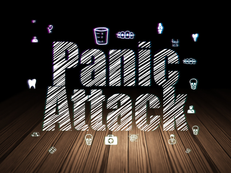 Health concept: Glowing text Panic Attack,  Hand Drawn Medicine Icons in grunge dark room with Wooden Floor, black background