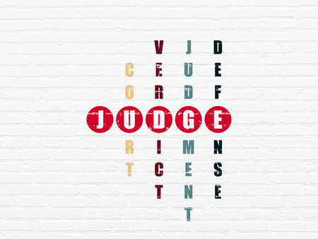 Law concept: Painted red word Judge in solving Crossword Puzzle