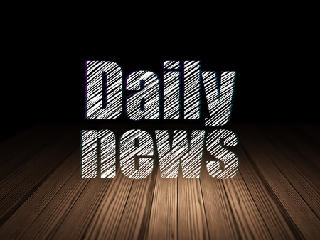 News concept: Glowing text Daily News in grunge dark room with Wooden Floor, black background Stock Photo