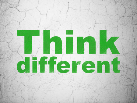Learning concept: Green Think Different on textured concrete wall background