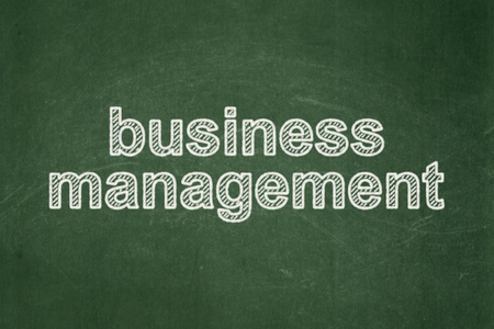 Finance concept: text Business Management on Green chalkboard background