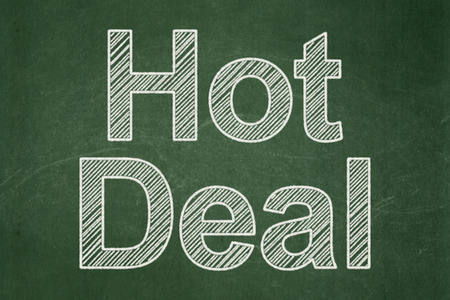 Business concept: text Hot Deal on Green chalkboard background