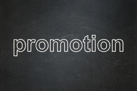 Marketing concept: text Promotion on Black chalkboard background