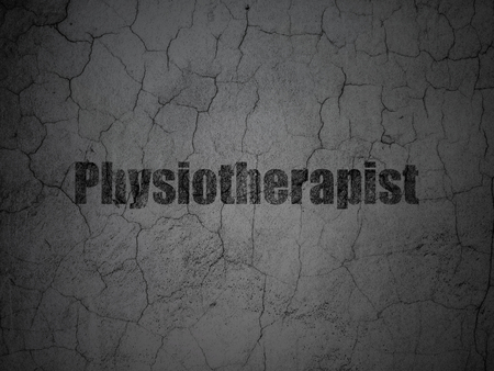 pharma: Medicine concept: Black Physiotherapist on grunge textured concrete wall background