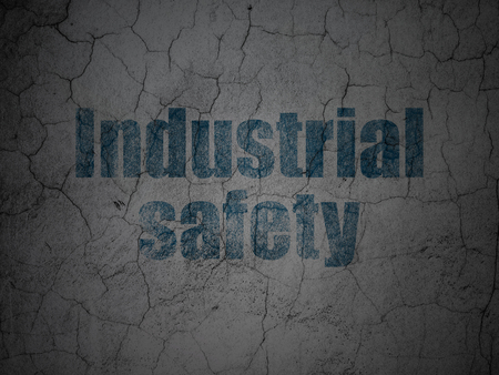 Construction concept: Blue Industrial Safety on grunge textured concrete wall background Stock Photo