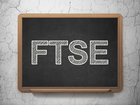 britannia: Stock market indexes concept: text FTSE on Black chalkboard on grunge wall background, 3D rendering Stock Photo