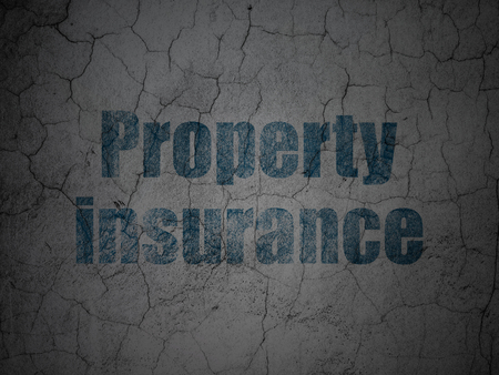 Insurance concept: Blue Property Insurance on grunge textured concrete wall background