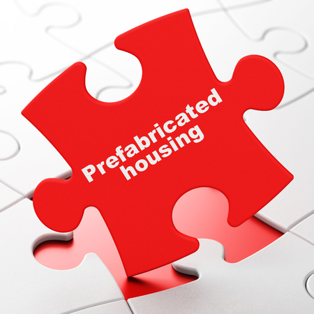 Construction concept: Prefabricated Housing on Red puzzle pieces background, 3D rendering