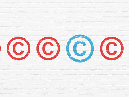 Law concept: row of Painted red copyright icons around blue copyright icon on White Brick wall background