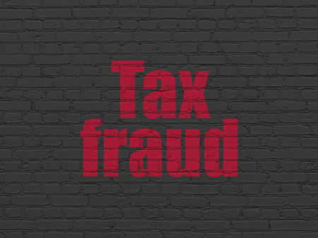Law concept: Painted red text Tax Fraud on Black Brick wall background Stock Photo