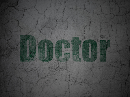 weathered: Health concept: Green Doctor on grunge textured concrete wall background