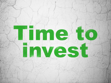 Time concept: Green Time To Invest on textured concrete wall background