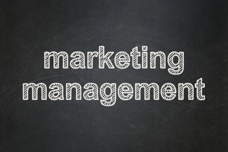 Marketing concept: text Marketing Management on Black chalkboard background