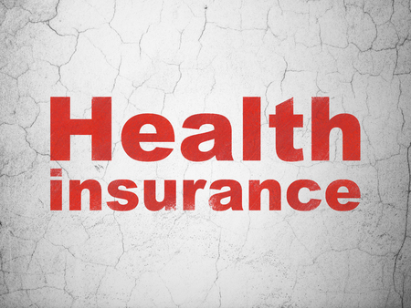 Insurance concept: Red Health Insurance on textured concrete wall background